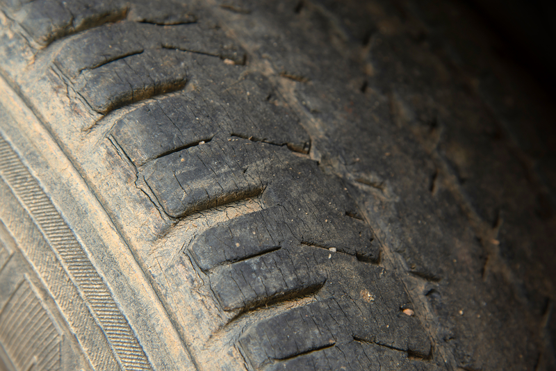 Damaged and worn black tire tread